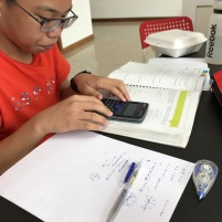 Dunman High Yishun student doing A Math Trigonometry in advance of school. Tutors teach from the beginning until students master the topic. Notice his working too, random shot, and all working is shown.